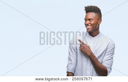 Young african american man over isolated background cheerful with a smile of face pointing with hand and finger up to the side with happy and natural expression on face looking at the camera.