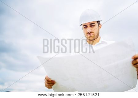 View Of Engineer Working On Construction Site. Civil Engineering Details