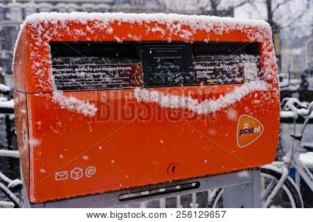Leiden, Netherlands, 10 December, 2017: Image Of The Orange Mailbox Owned By The Post Nl, Holland Po