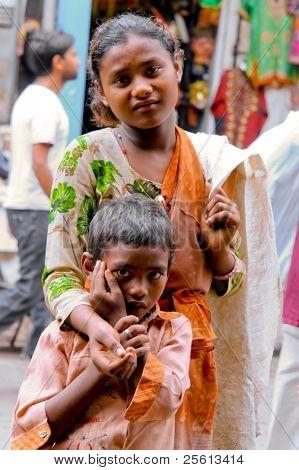 DELHI - SEPTEMBER 26: Young beggars on street on September 26, 2007 in Delhi, India. They often collect plastic bottles to earn extra money.