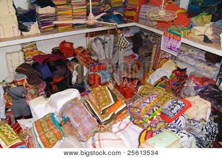 DELHI - DECEMBER 2: A customer shops in a textile warehouse intended for export on December 2, 2007 in Delhi, India. Textiles exports may touch $24 billion in 2010-11