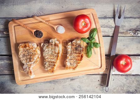 Grilled Pork Steaks On Cutting Board. Top View.
