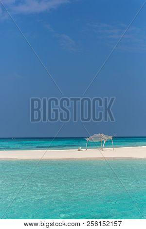 Amazing Blue Water In A Desert Island In A Blue Sky Day