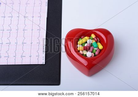 Rx Prescription, Red Heart, Asorted Pils And A Stethoscope On White Background