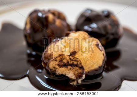 Delicious Profiteroles With Chocolate And Cream For Breakfast. Dessert.