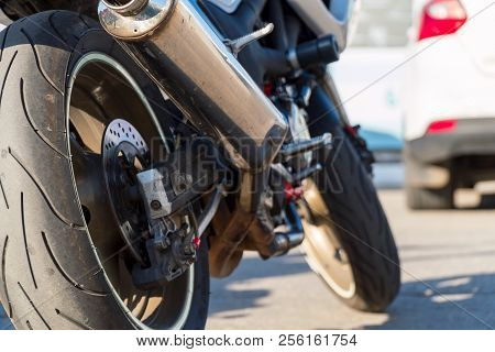 Rear View Of The Motorcycle. Rear Wheel, Exhaust Pipe. Soft Focus, Blurred Background.