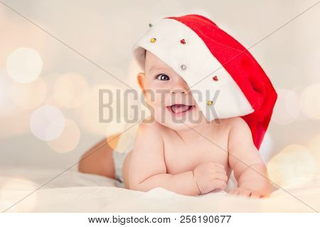 Beautiful Little Baby Celebrates Christmas New Year's Holidays Baby Red Hat Boken Background