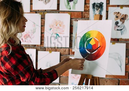 Painting Lessons And Art Classes. Teacher Explaining Dye Mixing Using Color Wheel. Skill Improvement