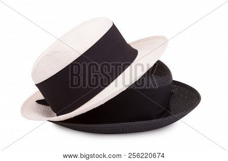 Black And White Straw Hat On A White Background. Two Straw Hats On A White Background. Black And Whi
