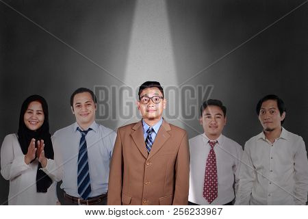 Recruitment In Business Concept. Young Asian Businessman Hilghlighted Among Other People