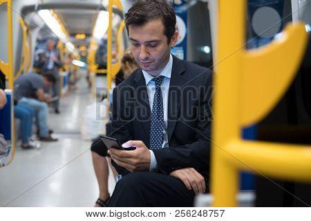 Commuter On Underground Is Going To Work