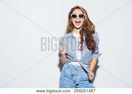Pretty Young Sexy Fashion Sensual Woman Posing On White Wall Background Dressed In Hipster Style Jea