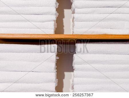 Bright Towels Folded In Shelf Close Up