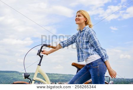 Woman Rides Bicycle Sky Background. How To Learn To Ride Bike As An Adult. Active Leisure. Healthies