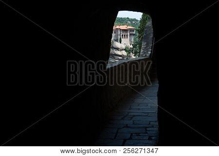 Meteors Or Meteora Monastery Of Varlaam Seen From Great Meteoron Corridor Tunnel, Thessaly, Greece