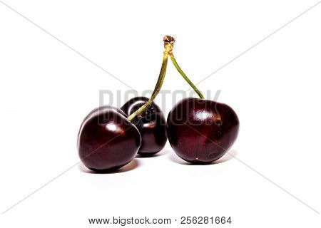 Intense Red Cherries On White Background. Healthy Food.