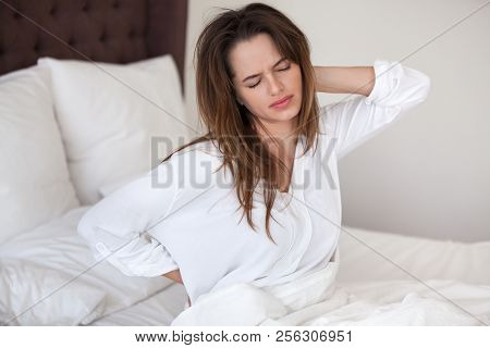 Unhappy Woman Waking Up In Bed Feeling Neck Back Pain