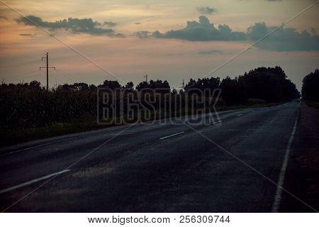 Rural Roads In Summer At The Sunset.rural Village Landscape.