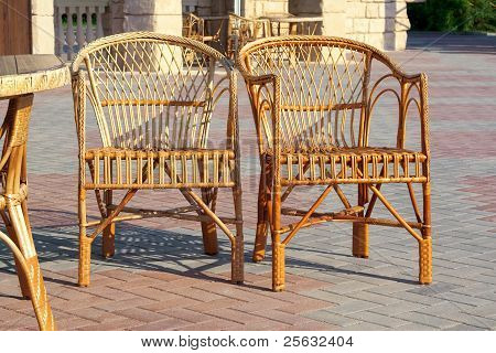 Two Wicker Chairs And A Table