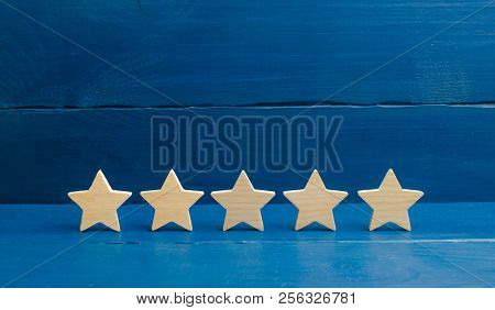 Five Stars On A Blue Background. The Concept Of Rating And Evaluation. The Rating Of The Hotel, Rest