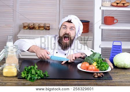 Chef Man. Kitchen Accessories, Cooking Equipment. Male Chef Cutting His Finger. Bearded Man Cut In H