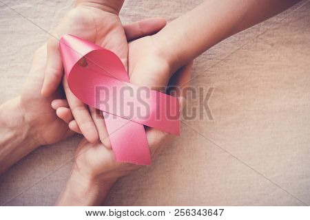 Hands Holding Pink Ribbon, Breast Cancer Awareness, October Pink Concept