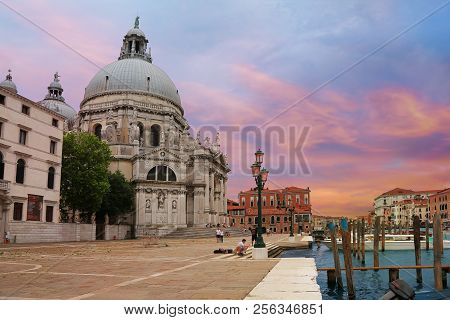 Venice, Italy, Jun 7, 2018: View Of Basilica Di Santa Maria Della Salute With Tourists Strolling And