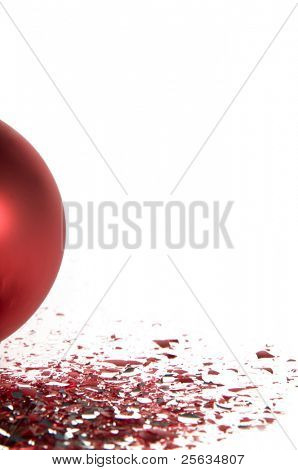 Red Christmas ball isolated on white background with glass splinters
