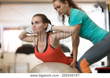 Fitness, Sport, Exercising And Health Concept - Young Woman And Her Personal Trainer In Gym