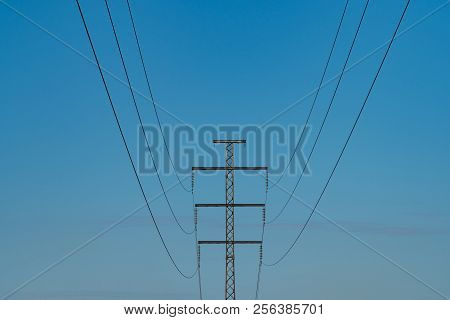 Single Power Line Against A Cloudless Sky