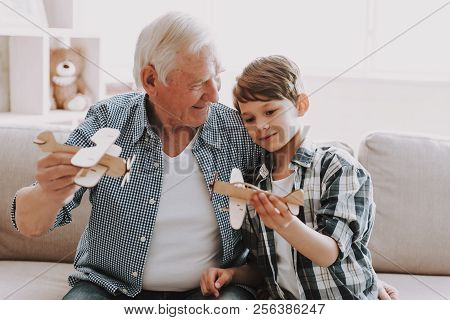 Portrait Grandpa And Grandson Playing With Toys. Family Relationship Between Grandfather And Grandso