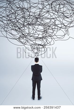 Confused Young Businessman With Scribble. Confusion And Think Concept