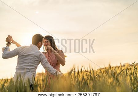 Romantic Couple on a Love Moment at gold wheat flied - Holambra, Sao Paulo, Brazil