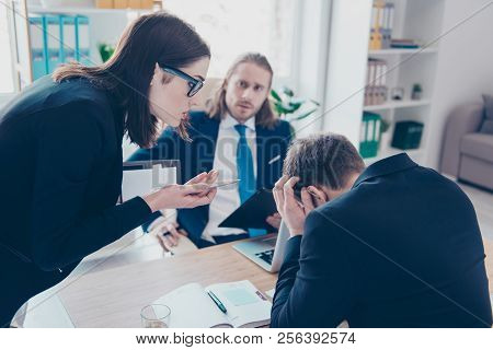 Young Lady Chief Boss In Glasses Wearing Jacket Having Quarrel With Employees About Overdue Financia