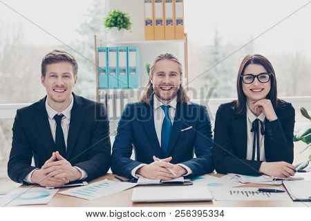 Stylish elegant modern three business partners in classic tux, tuxedo with tie having meeting appointment, discussing financial results, planning at work place station poster