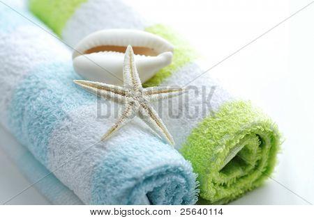 Spa still life. Shells on towels.