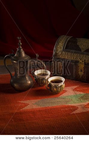 Arabic coffee cups in traditional setting.