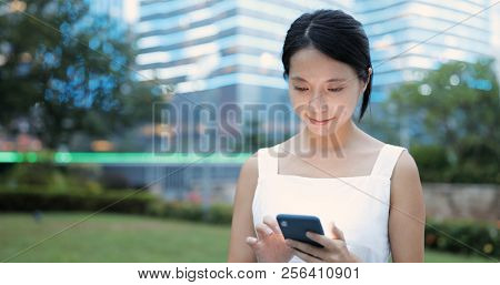 Young Woman use of mobile phone at night