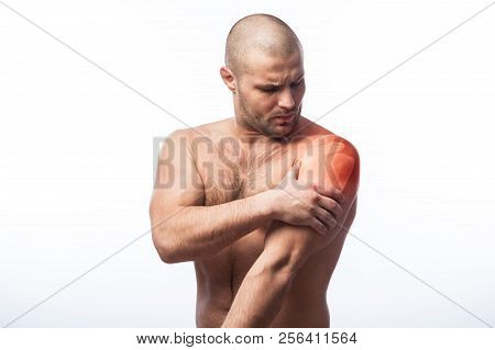 Injury To Forearm, Shoulder Pain Young Balding Athletic Man Holding A Sore Arm On A White Isolated B