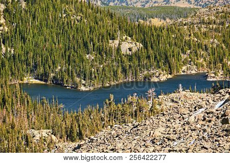 The Loch Lake with rocks and mountains around at autumn. Rocky Mountain National Park in Colorado, USA.