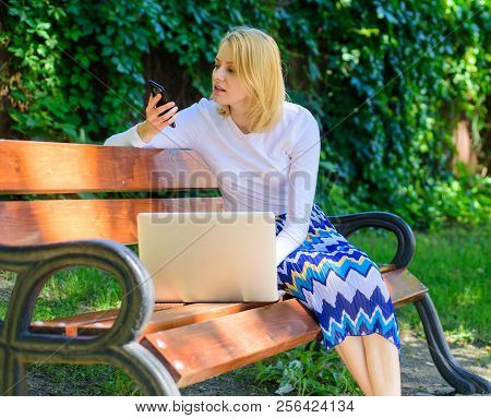 Woman With Laptop Works Outdoors. Business Lady Solving Problems Remote. Girl Smartphone Call Solve