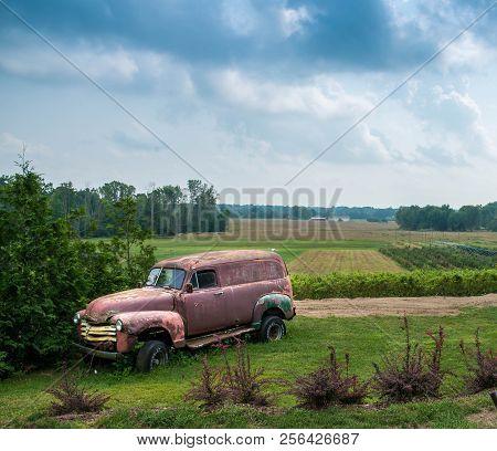 Rusty Old Panel Truck That Has Been Sitting In A Farm Field For A Long Time On August 26th 2018 At 2