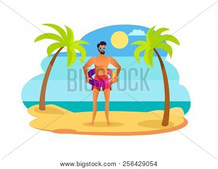 Man In Sunglasses And Red Swimming Trunks With Shiny Lifebuoy. Handsome Suntanned Guy Wears Swimwear