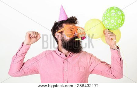 Celebration Concept. Guy In Party Hat With Air Balloons Celebrates. Hipster In Giant Sunglasses Cele