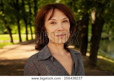 Beautiful Mature Woman Face. Mid Adult Lady Smiling Outdoors