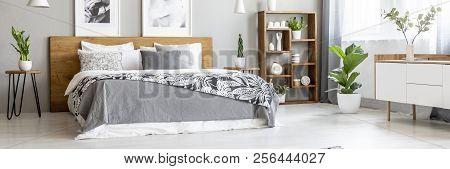 Scandinavian Style, Wooden Furniture In A Stylish, Monochromatic Bedroom Interior With Plants, Gray