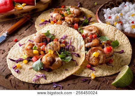 Delicious Spicy Shrimp Tacos With Sriracha Mayo On A Rustic Wood Table Top.