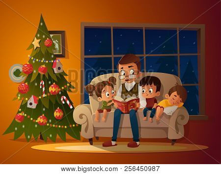 Grandfather Sitting With Grandchildren On A Cozy Sofa With The Book, Near Christmas Tree. Reading An
