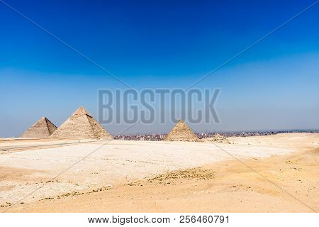 Egypt. Cairo - Giza. General View Of Pyramids From The Giza Plateau (from Left: The Pyramid Of Chufu
