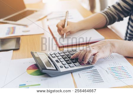 Close Up Hand Of Business Employee Accountant With Calculator Calculating Annual Income Tax And Comp